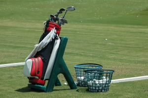Golf-bag-and-buckets-of-balls